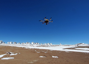 """The Hexacopter"" by ALMA (ESO/NAOJ/NRAO) - http://www.eso.org/public/images/ann13067a/. Licensed under CC BY 4.0 via Wikimedia Commons - http://commons.wikimedia.org/wiki/File:The_Hexacopter.jpg#/media/File:The_Hexacopter.jpg"