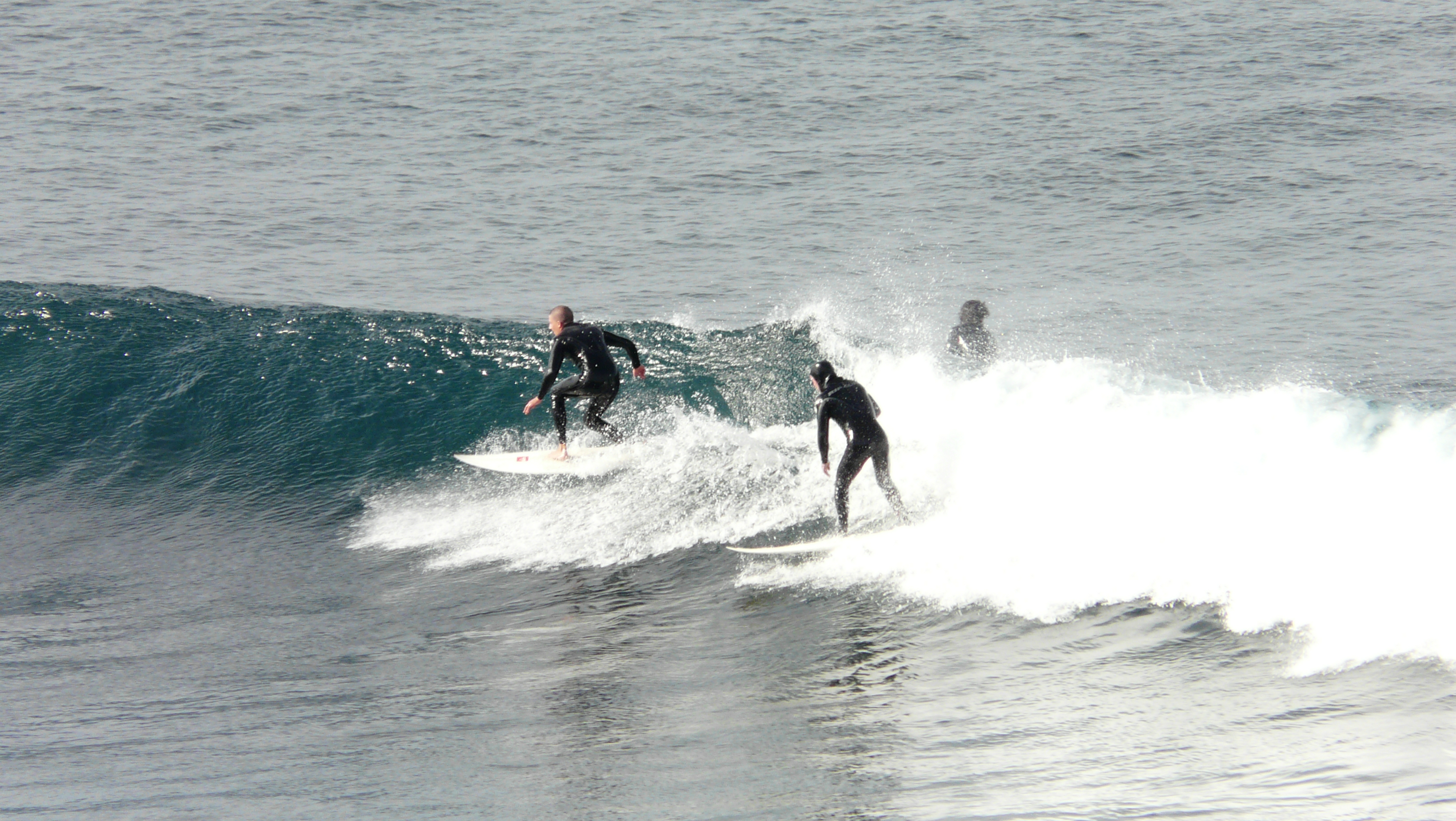 Surfers at Bells Beach, Victoria, Australia