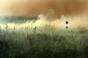 The Michigan Army National Guard uses a bambi bucket, an aerial firefighting tool suspended below a helicopter, to extinguish a fire 10 miles from Tahquamenon Falls State Park, Mich., Aug. 8, 2007. (U.S. Army photo by Staff Sgt. Helen Miller) (Released)