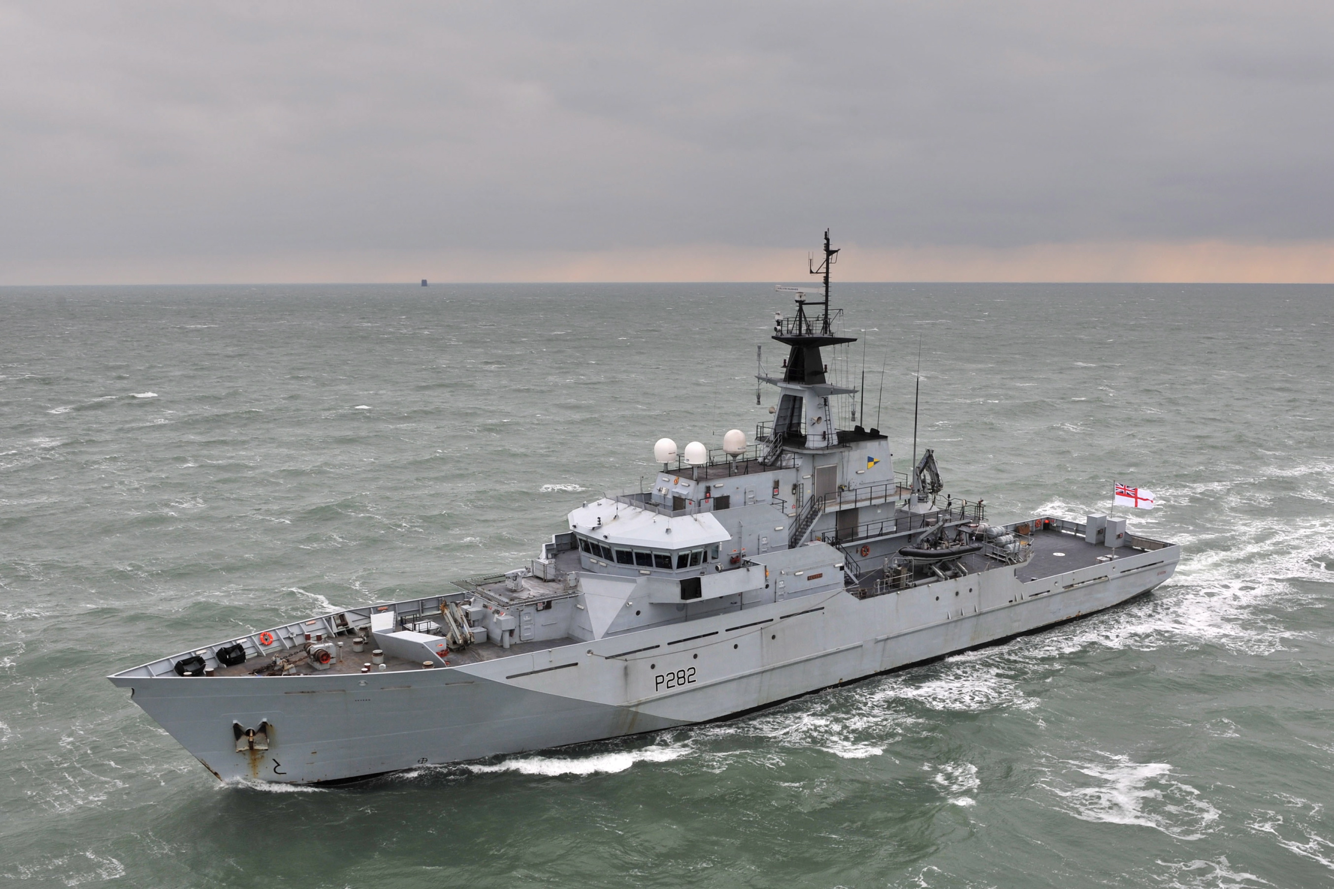 River Class Patrol Vessel HMS Mersey of the Fishery Protection Squadron is pictured at sea near Portsmouth. HMS Mersey is the youngest of the original batch of River- class patrol vessels built for the Fishery Protection Squadron – the oldest unit in the Royal Navy. She patrols the waters of the UK and up to 200 miles in the Atlantic ensuring that fishing boats and trawlers stick to internationally-agreed quotas. Mersey was the last ship to be built at Vosper Thornycroft yard in Woolston, Southampton. Mersey like her sister ships is not owned by the RN, she is in fact leased by BAE who retain the responsibility for any major maintenance and upkeep. The ship is a regular visitor to UK ports and often hosts organised groups to show what the Royal Navy is about. She operates a crew rotation system which means that a member of the ship's company would normally spend four weeks onboard and two weeks ashore catching up on leave or on courses, allowing the ship herself to be on almost constant patrol.