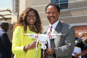 Essex County College President Dr. Gale E. Gibson (left) and Essex County College Public Safety Director Anthony Cromartie display a drone donated to the school. (Courtesy Essex County College)