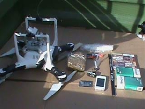 Unmanned aerial vehicle and contraband found on the grounds of Oklahoma State Penitentiary. Credit: Oklahoma Department of Corrections