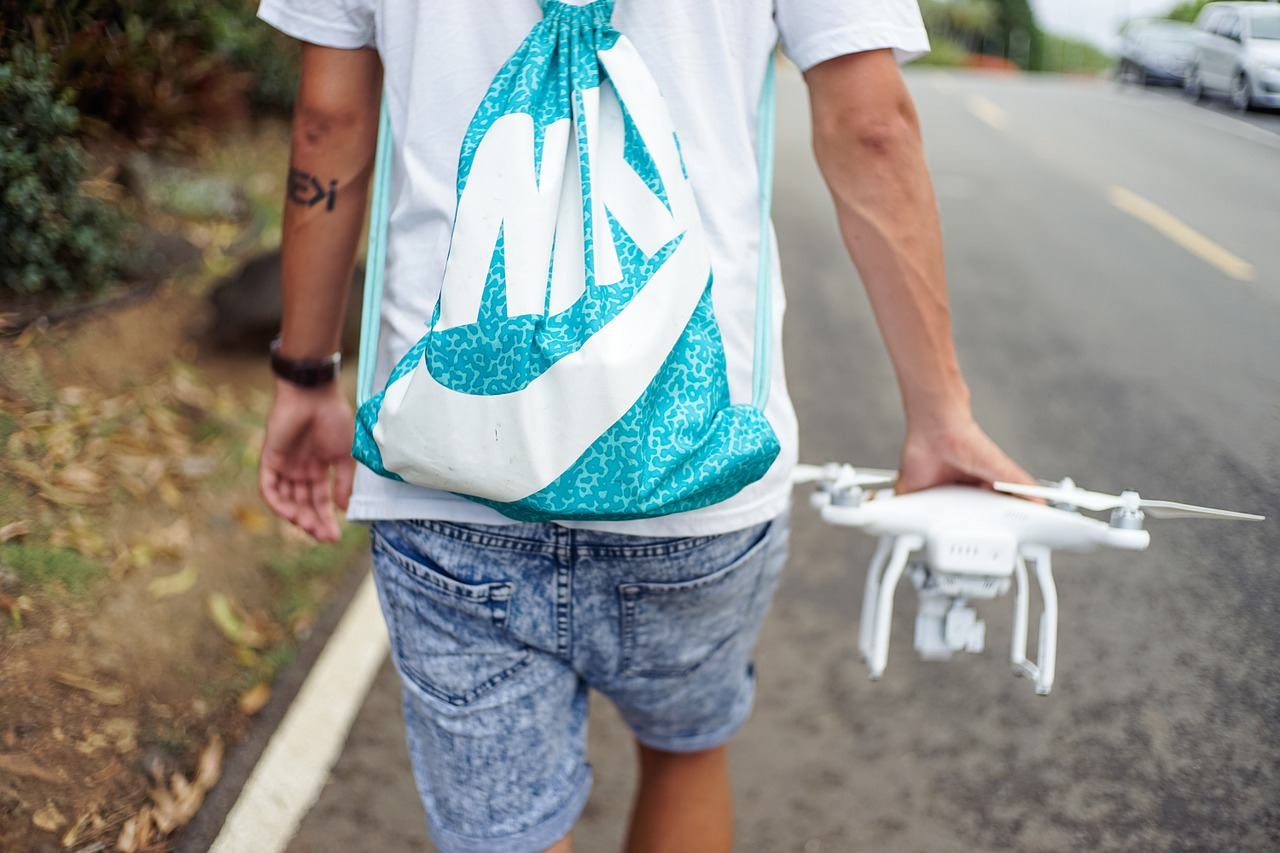 Man walking with DJI Phantom quadcopter