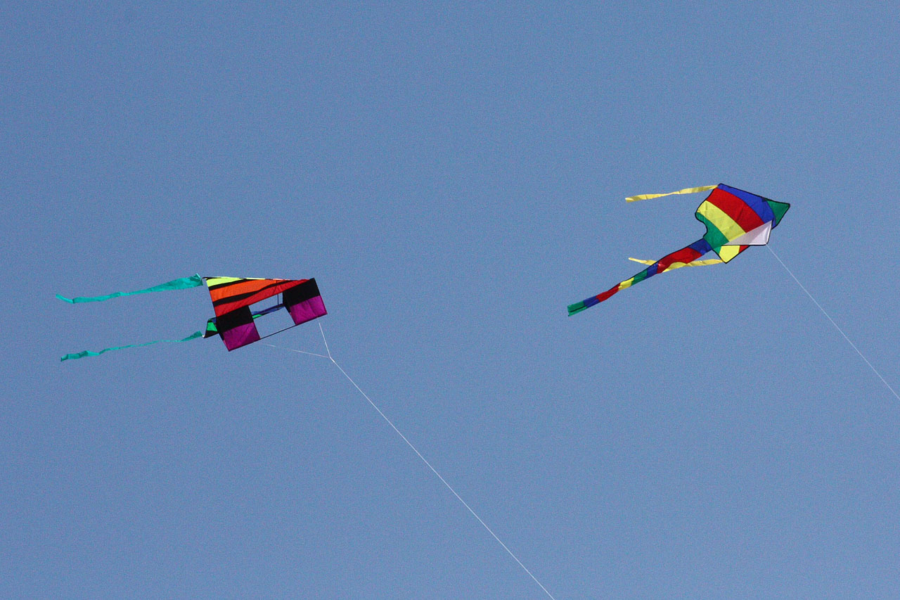 Two Colorful Kites Flying Overhead, Andrew Schmidt