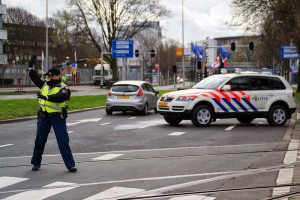 Dutch police woman regulates traffic at NSS, Credit: Wikimedia Commons