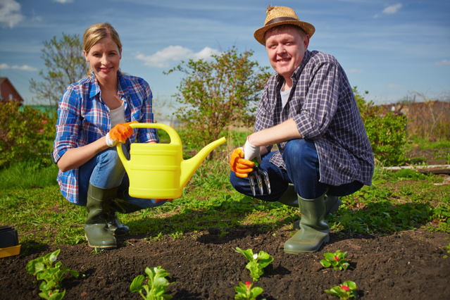 Couple Of Farmers Working In The Garden, Credit: Stock Image