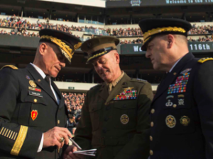Marine Corps Gen. Joseph F. Dunford Jr., center, chairman of the Joint Chiefs of Staff, speaks with Army Chief of Staff Gen. Mark A. Milley, Credit: DoD