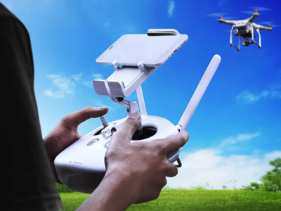 Drone pilot flying DJI drone, Credit: Stock Photography